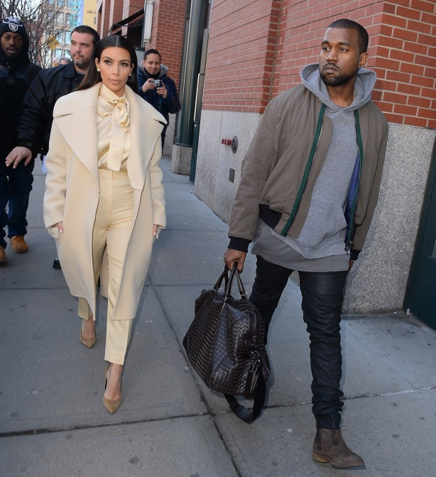 Kanye West proves chivalry is not dead as he assists Kim Kardashian to the car