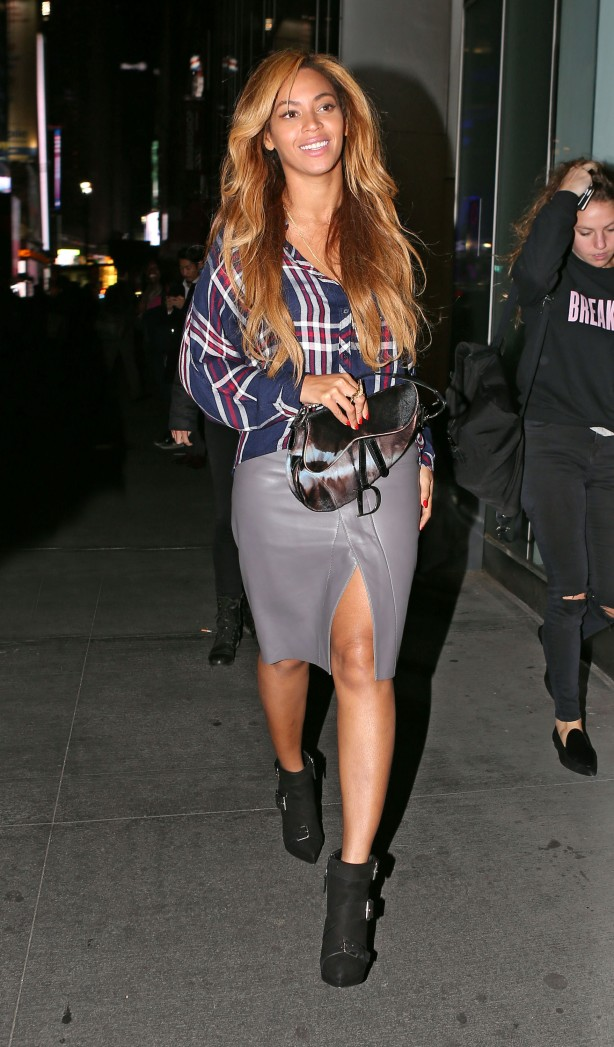 Beyonce out and about in NYC wearing a tartan top and leather skirt