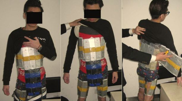 Customs officers in Shenzhen, China detained a Hong Kong man trying to smuggle 94 iPhones into Mainland China from Hong Kong Monday, Jan. 12, 2015. The unidentified man had the phones worth $49,000 taped to his body, police said. (Credit: Shenzhen Huanggang Customs)